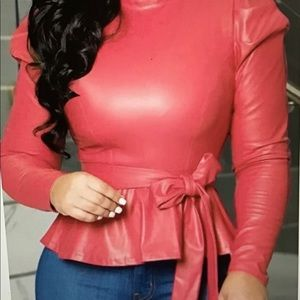 Women's Rose colored top with belt, long sleeves.